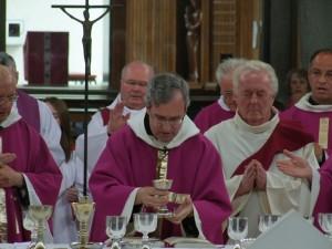 abott says Mass